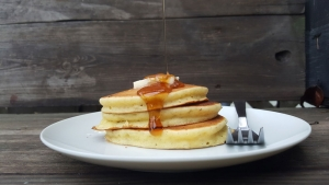 plate of pancakes with maple syrup