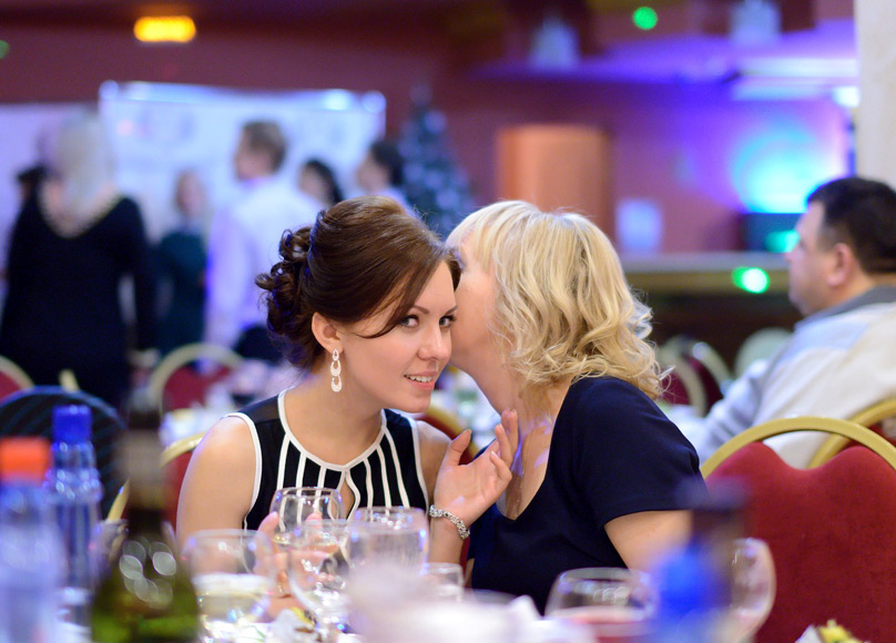 corporate event - two ladies talking