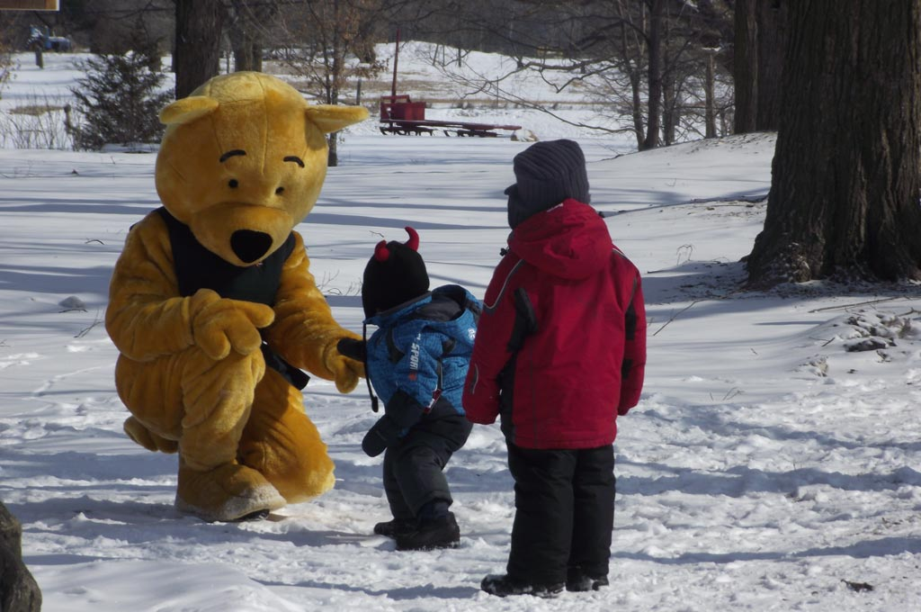 Stanley the bear greets children