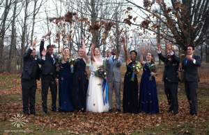 wedding party throw leaves in the air