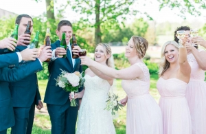 wedding party raise a cheer with wine and beer