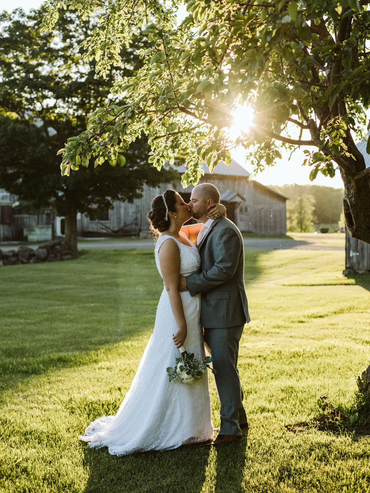 wedding couple kiss with sun setting