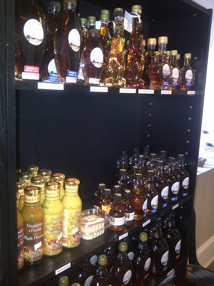 shelves with bottles of maple syrup