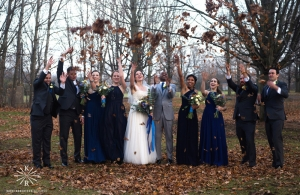 wedding party throwing leaves in the air