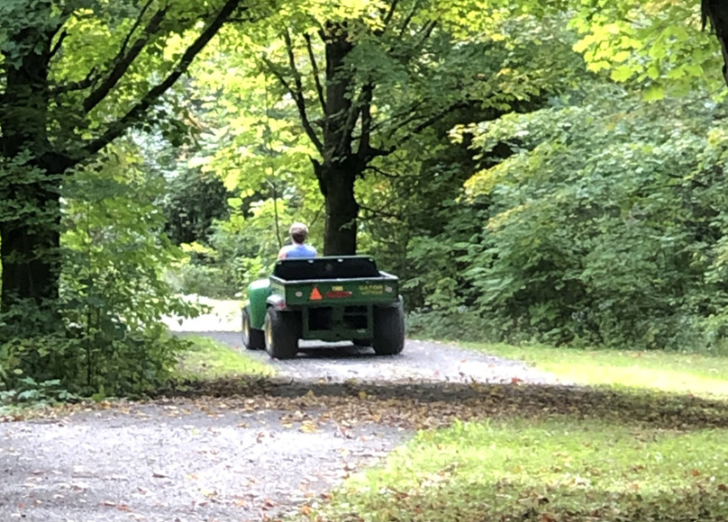 Kathy Gutscher driving away in 4-wheeler