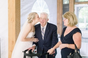 bride kisses her grandfather