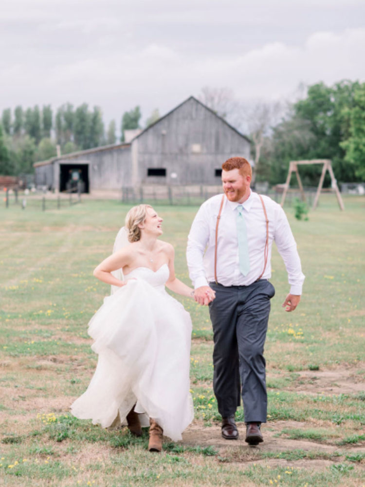 wedding couple running to camera