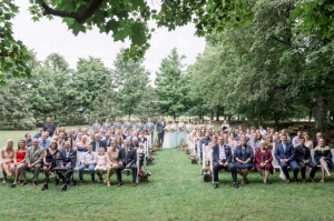 large group of wedding guests and wedding party