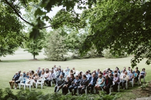 wedding guests sitting at outdoor ceremony