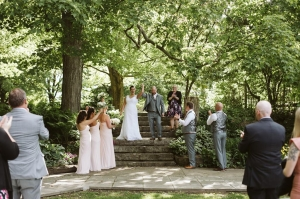 wedding couple raise arms after ceremony on Stone Steps