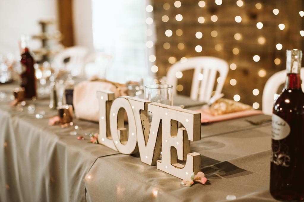 close up of head table with 'Love' center piece