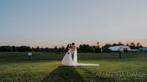 Couple kissing at sunset - photo by Samantha Danis