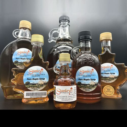 assorted maple syrup in glass bottles