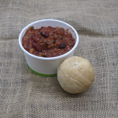 bowl of chili with fresh baked bun